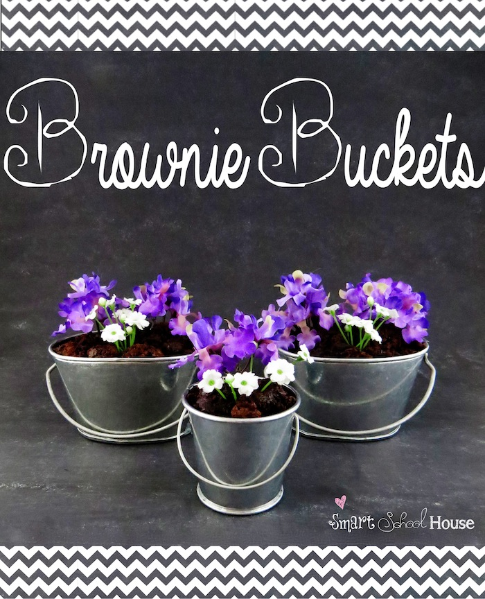 Brownie Buckets are #brownie crumbles planted inside small galvanized buckets topped with silk flowers. A pretty way to entertain with sweets! #dessert #diy