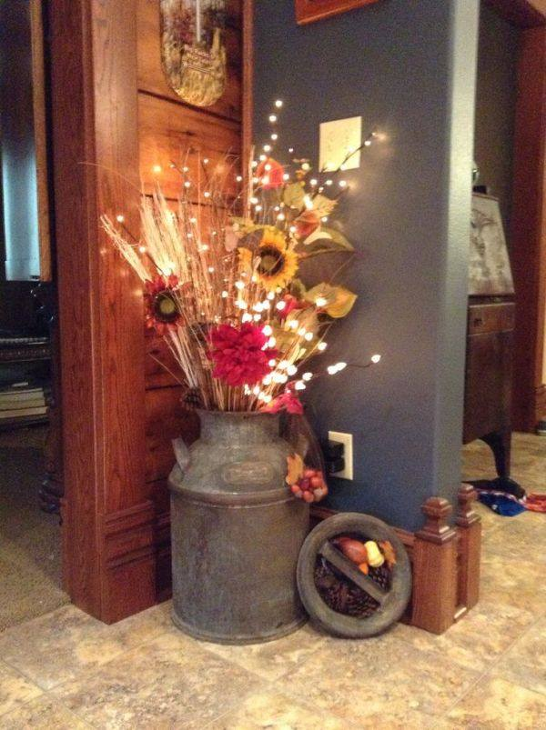 What a beautiful way to decorate your entry way! With lighted florals illuminating the autumn colors.