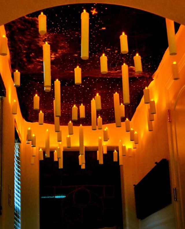 Floating candles from the ceiling for Halloween! WOW! Scary and amazing at the same time!