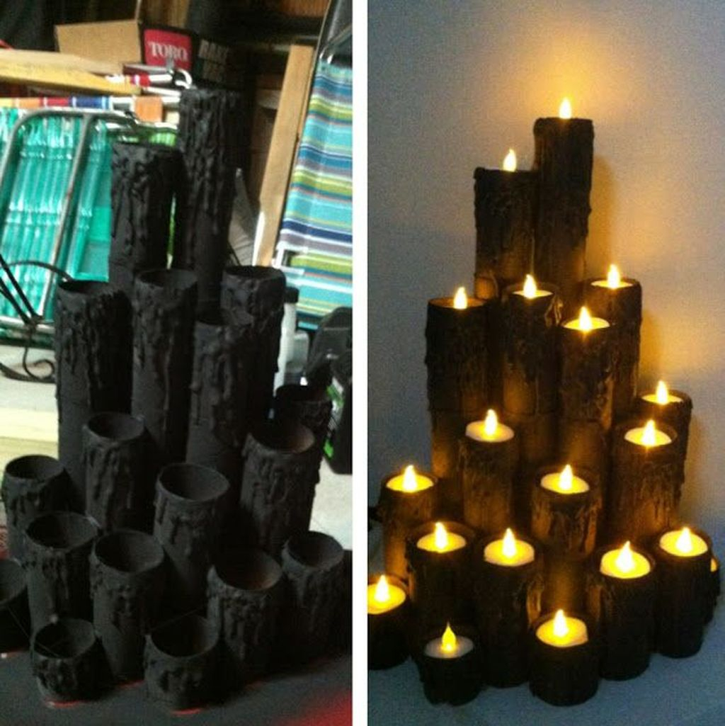 Black Dripping Candle Holders Filled with battery operated candles.
