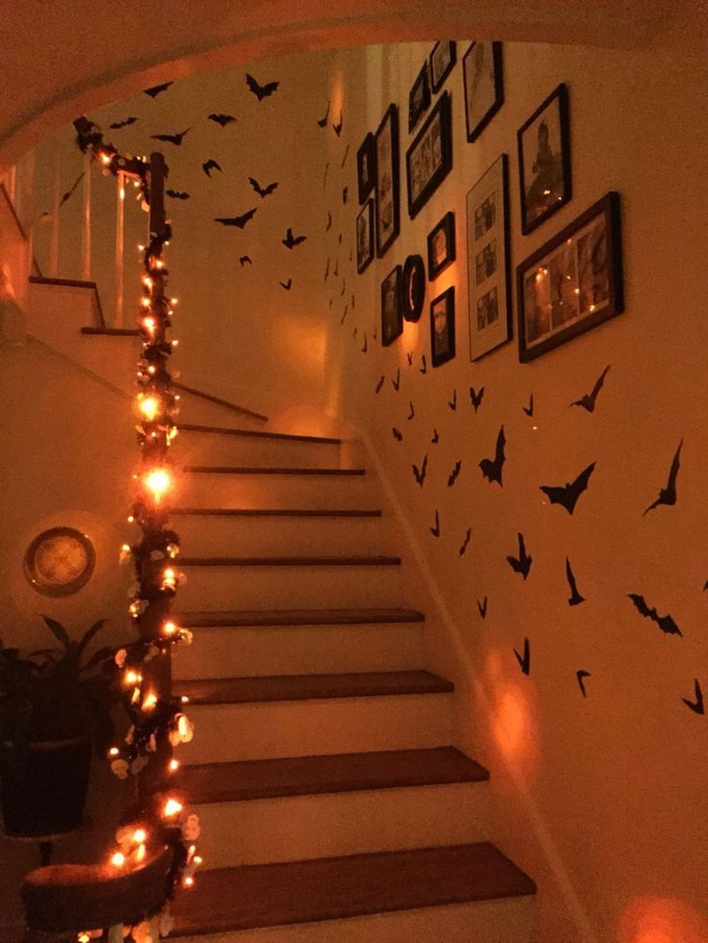 Halloween Staircase Decorated with paper bats and orange lights