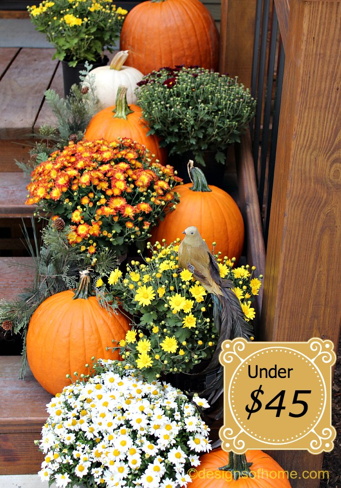 Pumpkins on Stairs - Cascading flowers, plants, and pumpkins on stairs.
