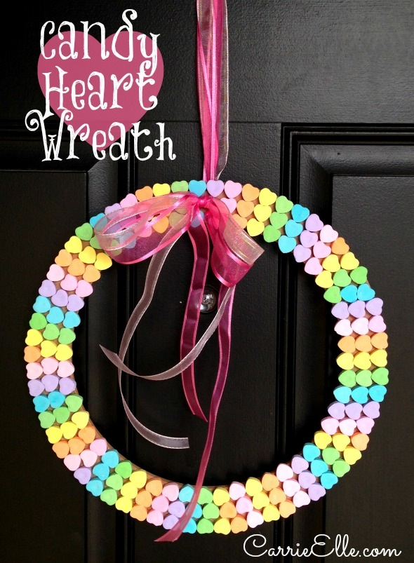 I have GOT to make one of these DIY Candy Heart Wreaths by Carrie Elle. OMG!