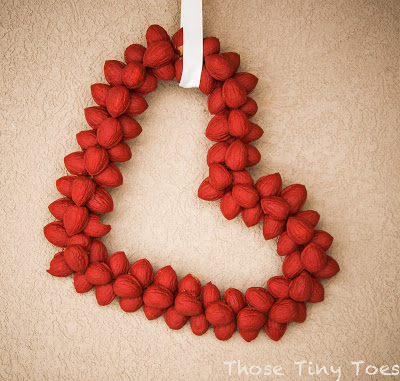 Can you believe that this DIY Valentine's Day Wreath by Those Tiny Toes is made out of, wait for it..... walnuts?!