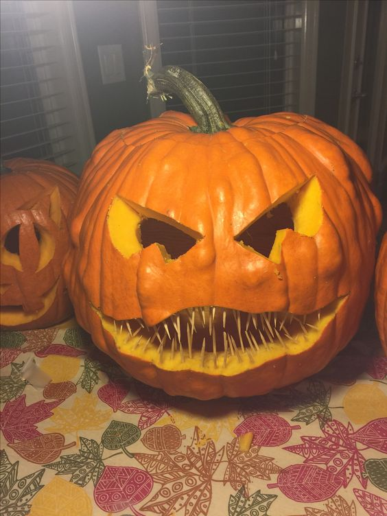 This creepy pumpkin idea uses toothpicks for the teeth. Creepy and easy pumpkin carving hack