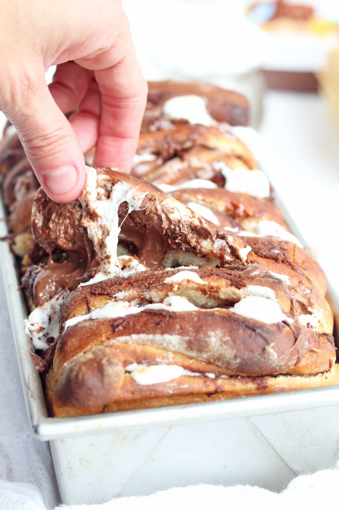 Chocolate Pull Apart Bread - Insanely good pull apart loaf is perfect to share with a crowd. Dough is made with graham cracker and layered and stuffed with Nutella and marshmallows. Sure to be a hit at every party!
