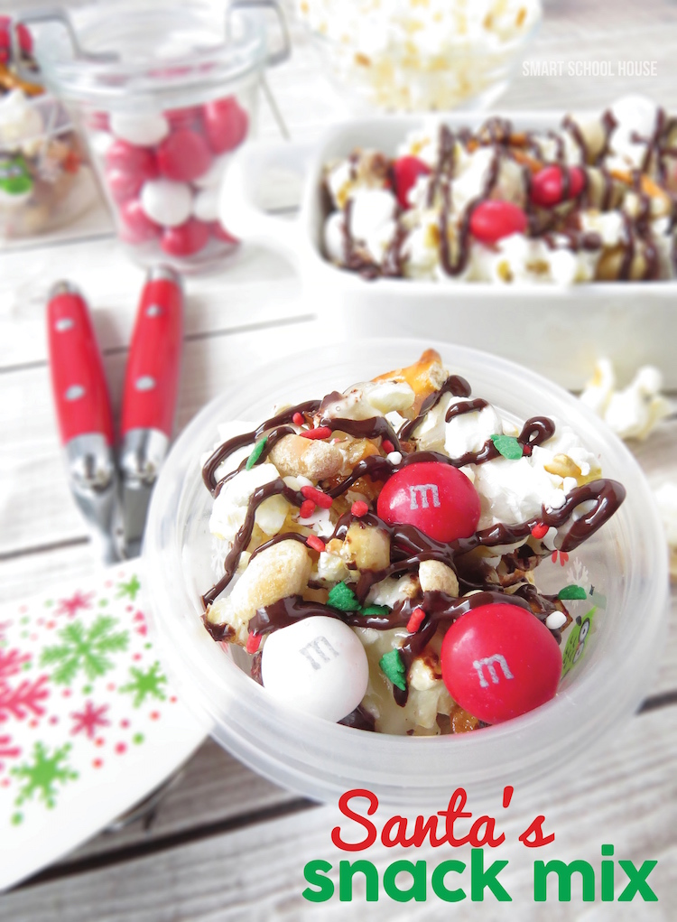 Santa's snack mix is an easy popcorn mix that is the perfect Christmas treat! Popcorn, pretzels, and nuts, coated with chocolate and mixed with M&Ms making the perfect sweet treat for parties or packaged for goody bags.