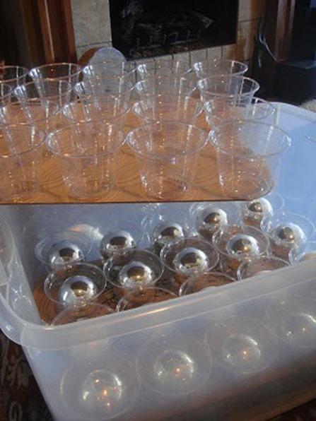 Glue Plastic Cups to Cardboard then Stack them in Plastic Bins
