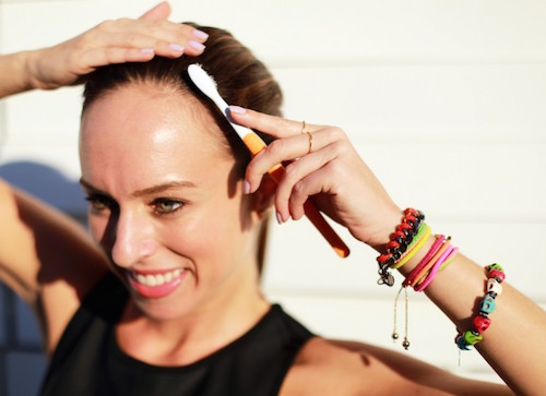 Use a toothbrush to tame your hair