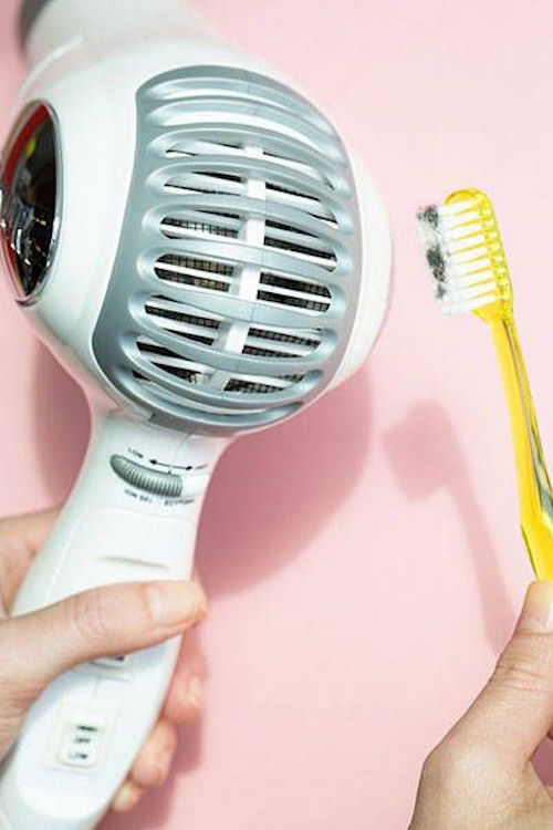 Clean out your hair dryer with a toothbrush