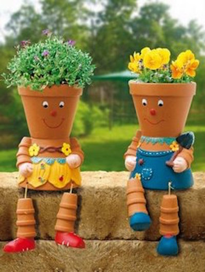 Flower pot people - made with paint, string, a glue gun, and flowers. So cute!