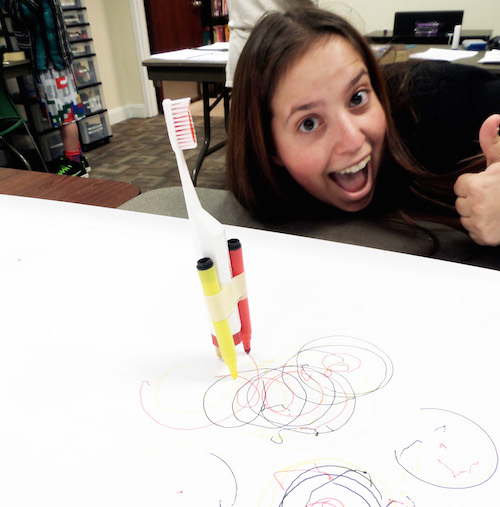 Use electric toothbrushes and markers to make mechanical squiggle machines