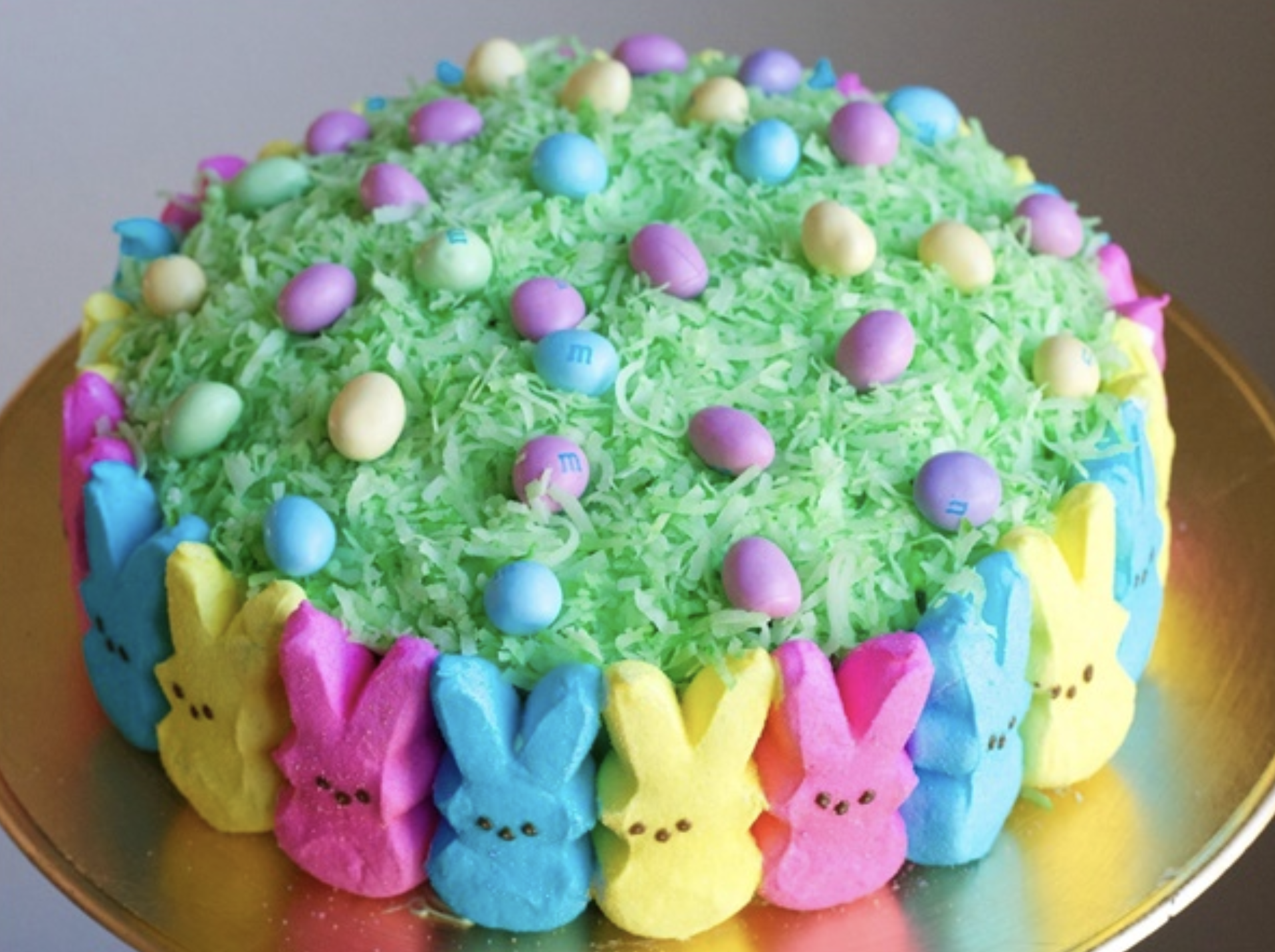 Easter Peep Cake - Need a creative Easter cake idea? Here it is ! This beautiful Easter peep cake is bright that decorated with the peeps and grassy hidden eggs.I love all the colors . It's so easy and fun to make!