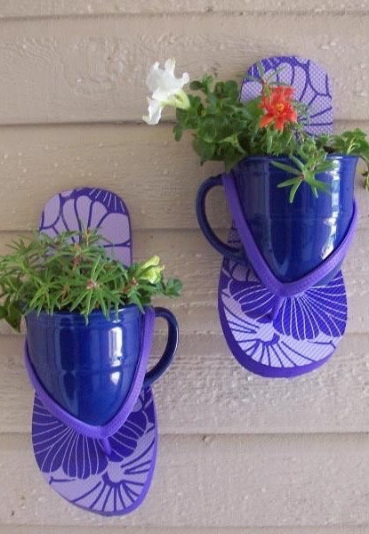 Use coffee cups and flip flops to hold small plants. How cute!