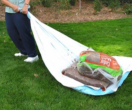 Use a table cloth to move heavy items in your garden