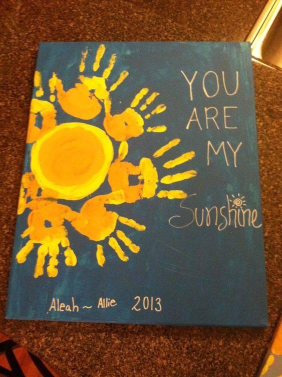 Sunshine handprint art. A cute art idea for kids to make in the summer!