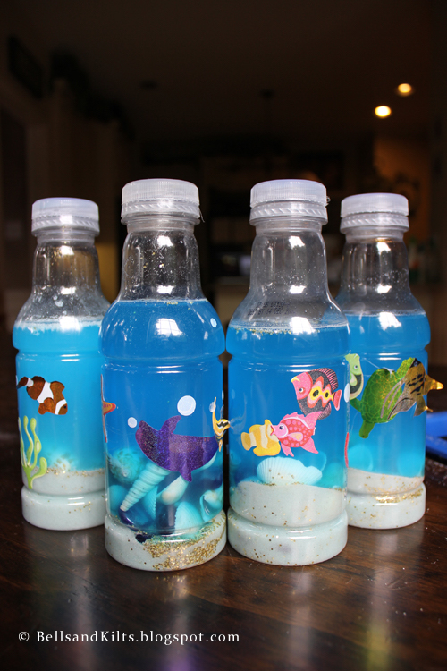 DIY ocean bottle craft for kids - how fun! Show your kids how to make these this summer!
