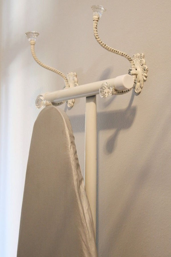 Why haven't I thought of this?Hang your ironing board using decorative wall hangers plus 13 Gorgeous Tidy Tips and Organization Hacks