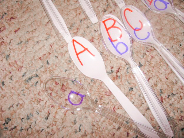 Create a simple game for matching upper and lower case letters with white and clear plastic spoons. This is a great activity to start before young students go back to school in the fall. It's amazing how some skills weaken over the summer without regular practice.