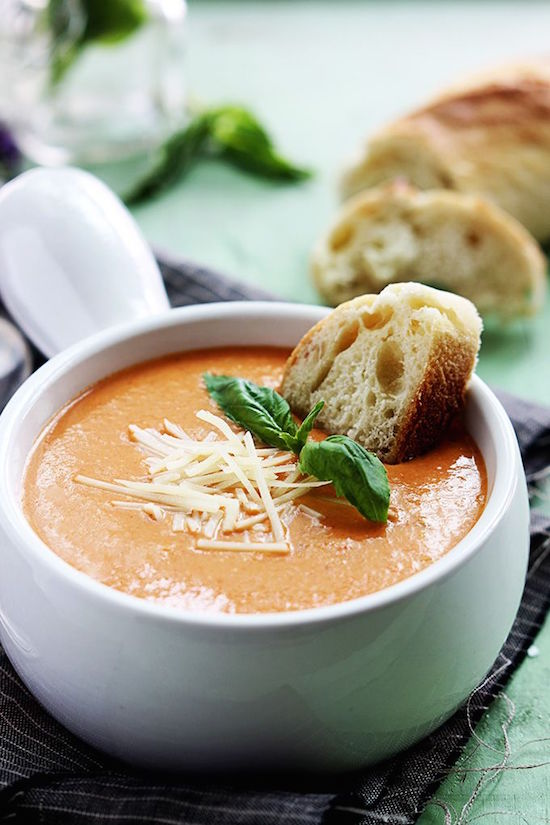 Creamy and rich tomato basil and cheesy parmesan soup made in the crockpot! Comfort food at its best!