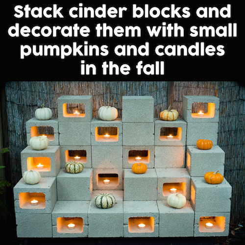 Stack cinder blocks and decorate them with small pumpkins and candles in the fall. Beautiful! Saving this idea -
