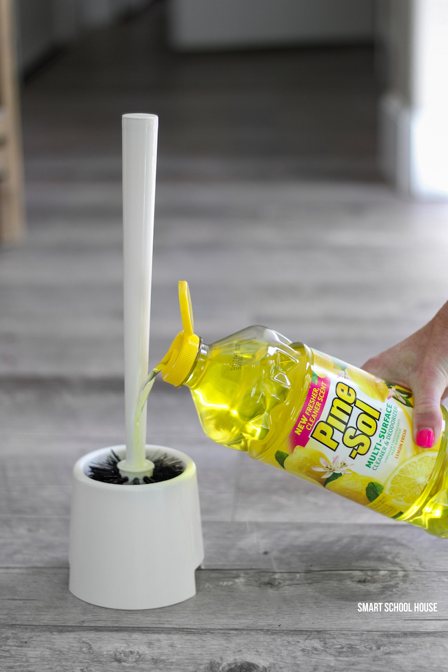 Use Pine Sol in the bottom of a toilet brush holder to keep bathrooms smelling lemon fresh at all times!