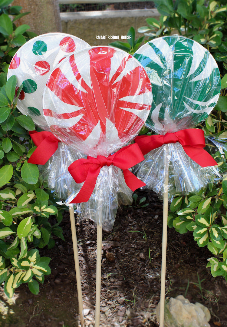 giant paper plate lollipops for christmas adorable super cute as a garden christmas decoration