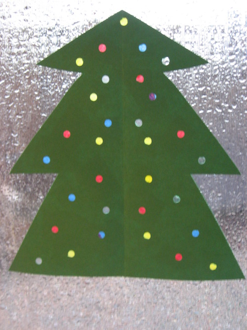 Show your kids how to make this colorful Christmas tree with tissue paper and a hole puncher!