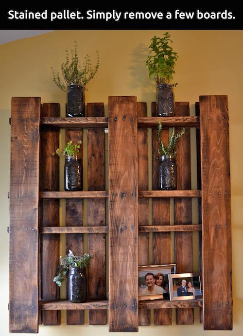 Remove a few boards from a wood pallet, finish it with a beautiful stain, and hang it. Easy enough!