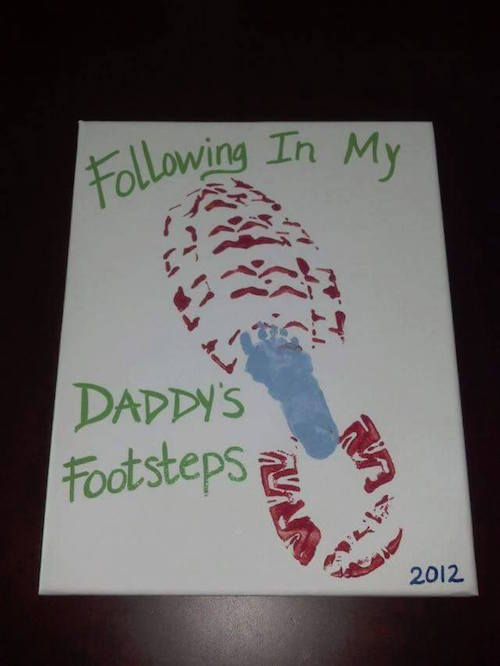 Footprint art just for Dads! This is such an easy and great DIY gift idea for Father's Day. Saving this....