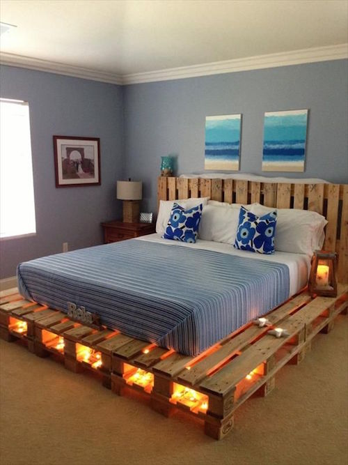 A wood pallet bed with lights underneath. How neat is this?