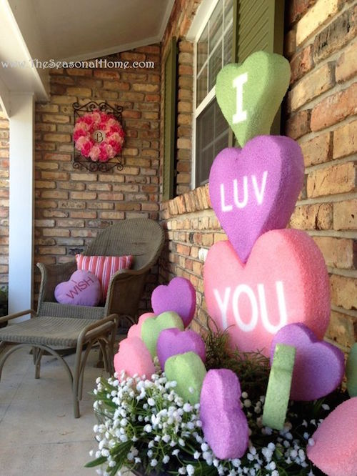 Make huge conversation heart decorations alphabet stickers, using spray paint, and styrofoam. MUST TRY!