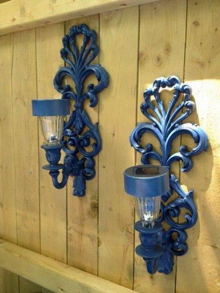 Make solar sconces for outside by removing the electric bulb and inserting a solar light - neat idea!