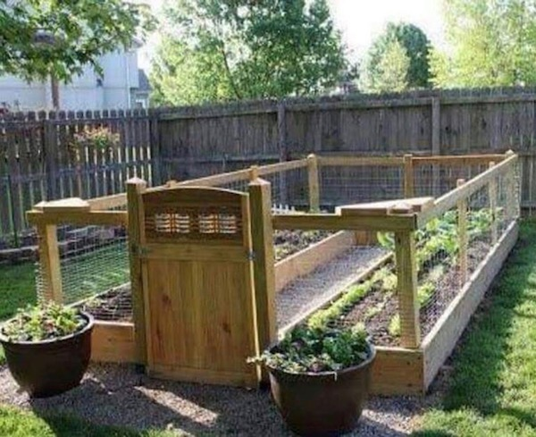 How to build a RAISED AND ENCLOSED GARDEN BED. Step by step instructions with a video