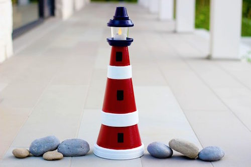 How to make a beautiful lighthouse using inexpensive clay pots and paint. LOVE this idea!
