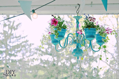 DIY Chandelier planter! Turn an old chandelier into a colorful hanging planter.