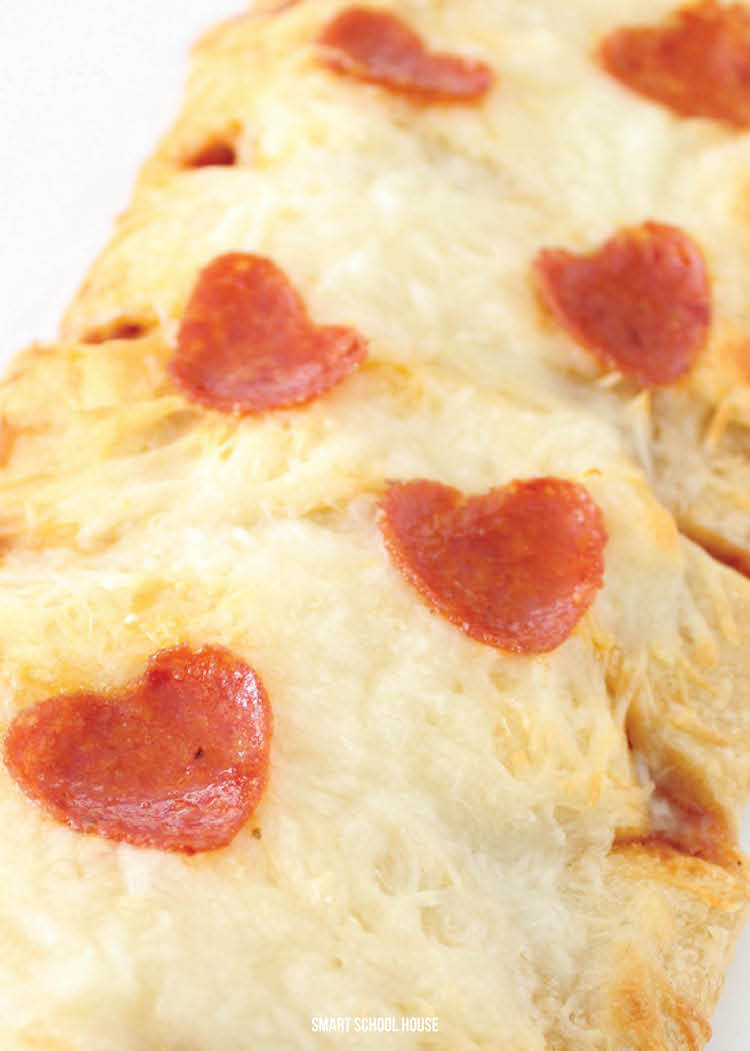 Valentine's Day Pizza with heart pepperoni pieces - so easy! #valentinesdayrecipe #valentinesdaydinner #valentinesdayfood #DIYvalentinesday #valentinesdayideas