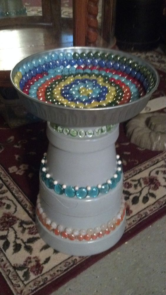 bird bath made from clay pots, paint and marbles