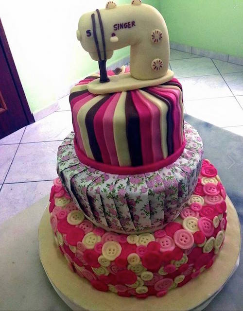 Sewing machine cake - complete with fondant buttons, fabric, and sewing machine on top. Amazing!