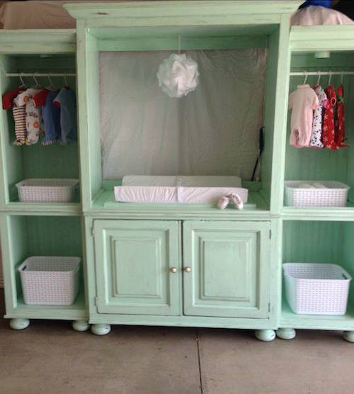 This is a re-purposed entertainment center. Doesn't it make a cute baby changing station? Great idea!