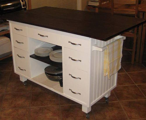 This started out as an old unused desk and they re-purposed it into a beautiful kitchen island. So smart!