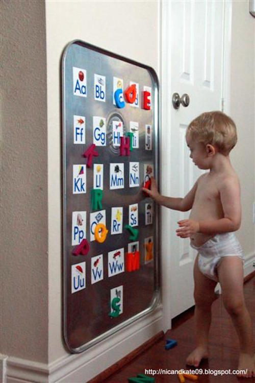 BIG Magnetic Board - made by hanging an oil drip pan from Walmart. So smart! Click the picture for details.