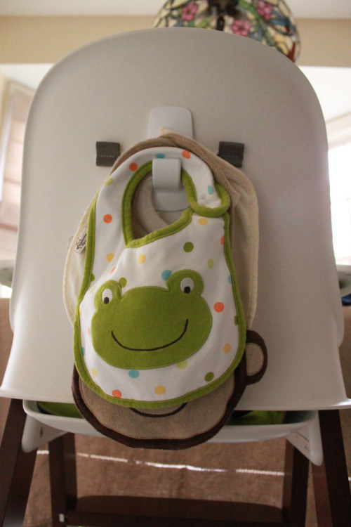Put a command hook on the back of your baby's high chair so you're never stuck frantically searching for a bib. So smart!