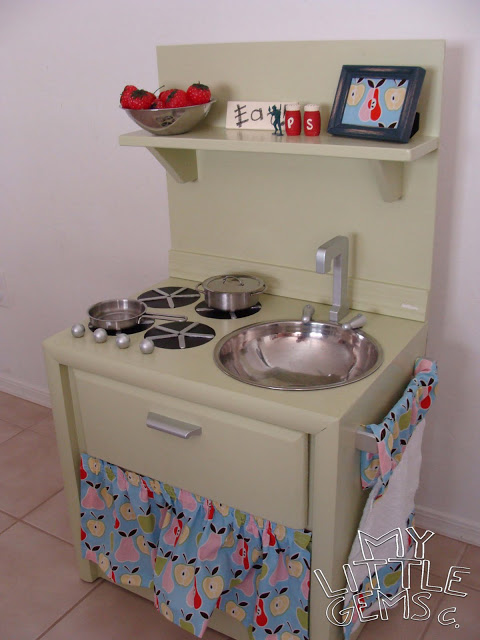 Here's another play kitchen idea, but instead of being repurposed out of cardboard boxes (see slide #3), this play kitchen is made from an old nightstand.