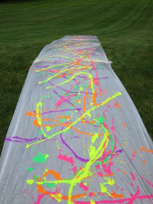 Make a huge paint slip 'n slide - neat idea! A little washable paint, a long piece of plastic, and some willing participants is all you need!