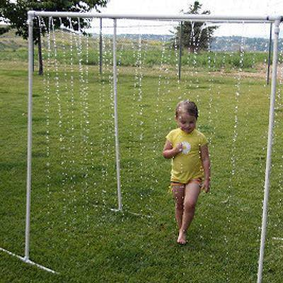 Make a sprinkler for kids to walk through by drilling holes in PVC pipes. So fun!
