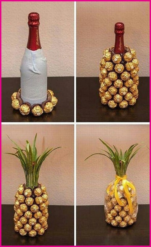 Wrap some duct tape around a bottle of champagne, stick on a bunch of Ferrero Rocher chocolates, and then add some grass fronds on top - neat!
