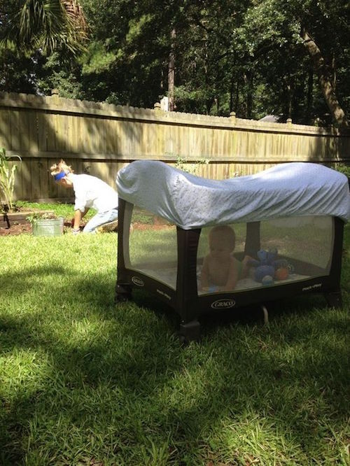 Put a fitted crib sheet over the pack 'n play to keep the bugs and direct sunlight away from the baby. So smart!