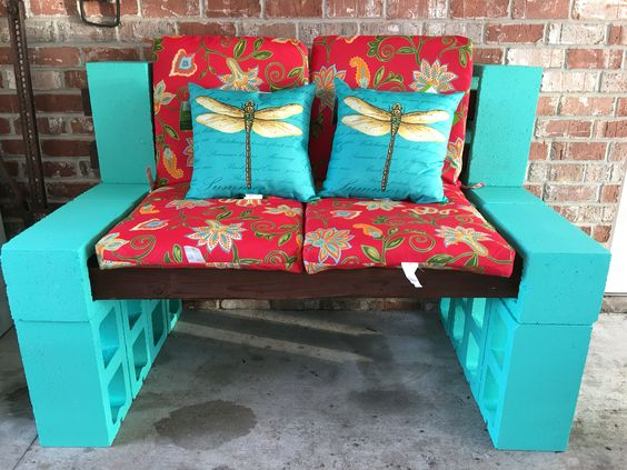 Cinder block bench made with stained wood and paint.