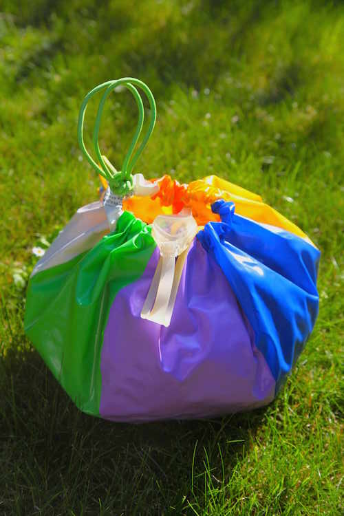 Turn a beachball into a beach tote! This is a great idea for a beach ball that no longer holds air.